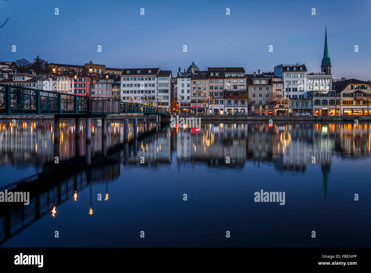 Row of houses of the old town of Zurich reflected on the Limmat River at night,Switzerland. - Stock Image