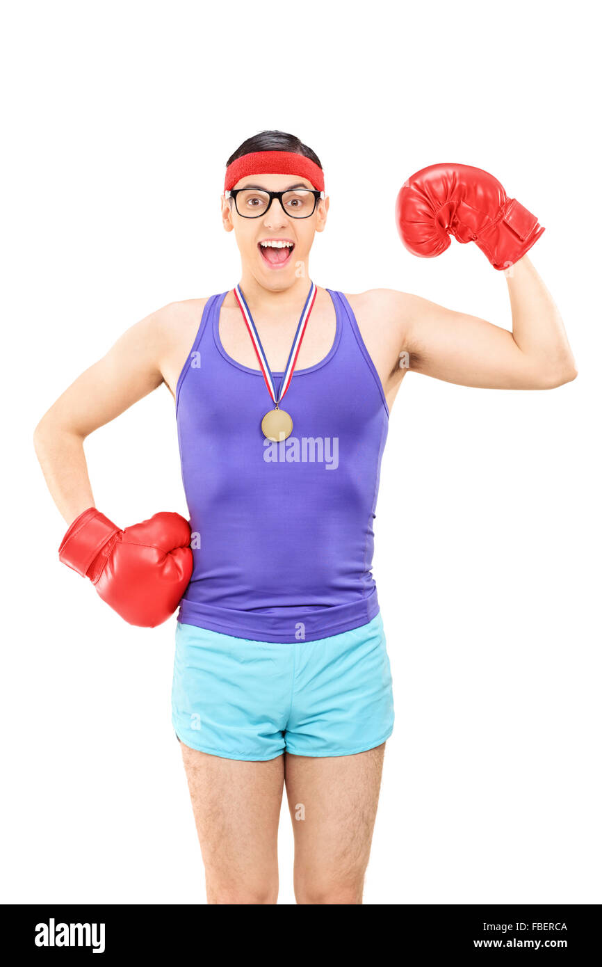 Vertical shot of a geeky guy with red boxing gloves wearing a medal isolated on white background - Stock Image