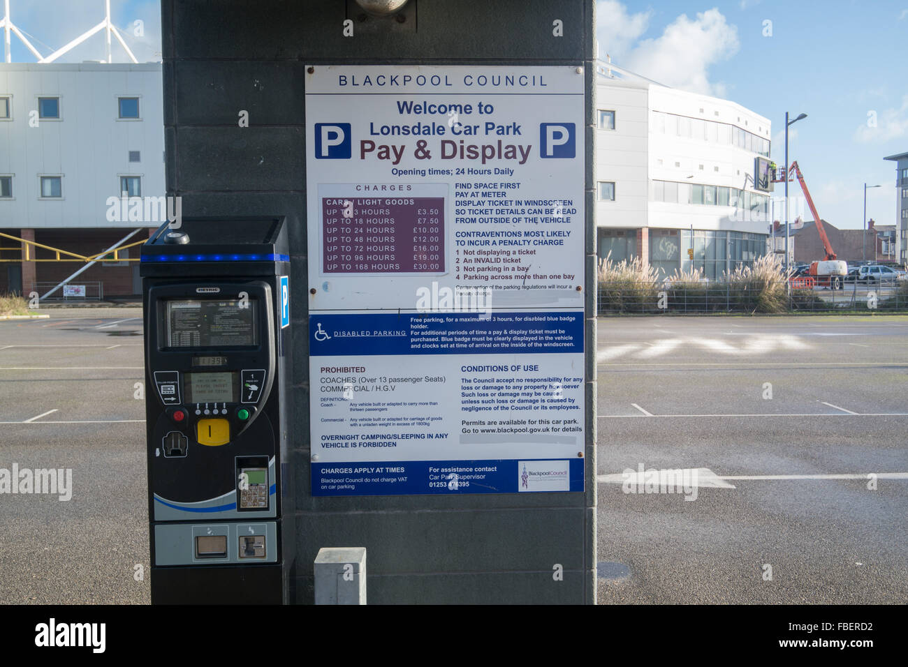 Parking ticket machine showing the charges for parking at Bloomfield road,car park - Stock Image