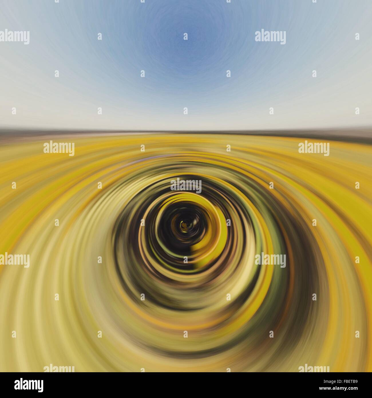 Digital Composite Image Of Spiral Field Against Sky - Stock Image