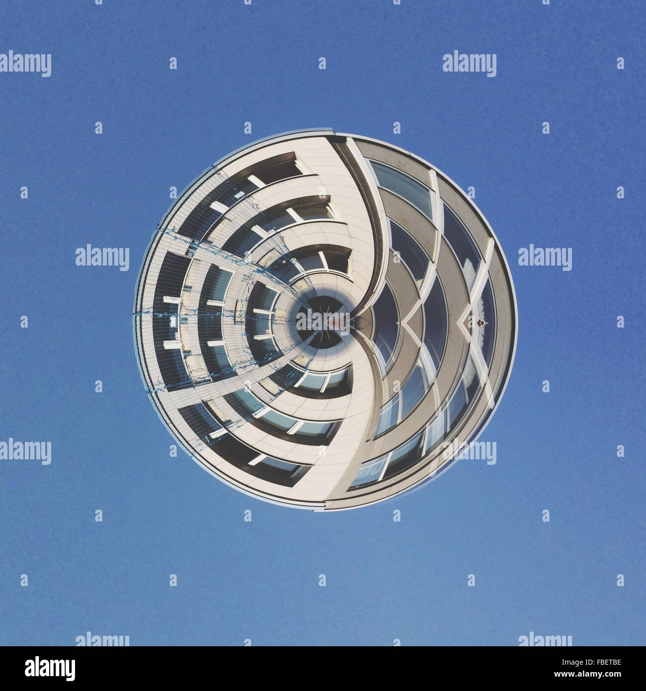 Digital Composite Image Of Building Against Clear Blue Sky - Stock Image