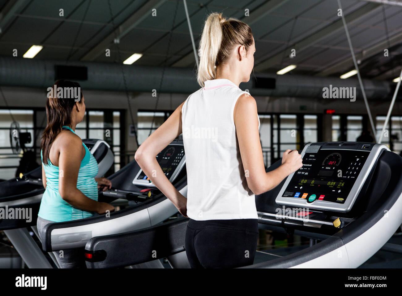 Women on treadmills - Stock Image
