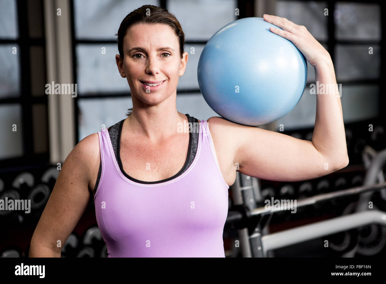Pregnant woman holding exercise ball - Stock Image