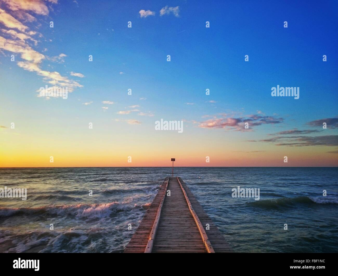 High Angle View Of Pier Over Sea Against Sky During Sunset - Stock Image