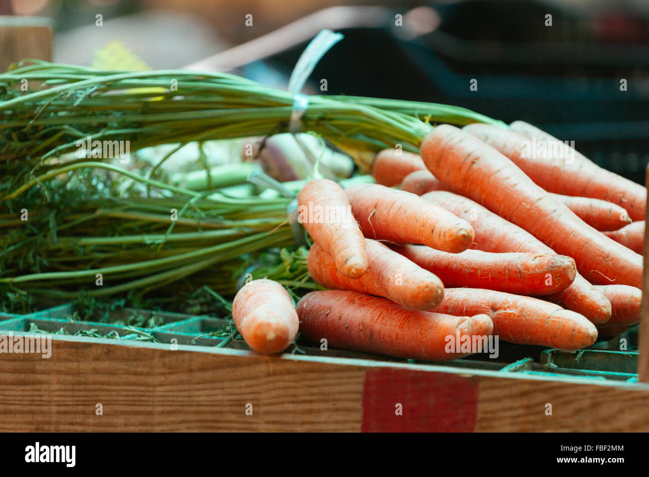 Close-Up Of Carrots On Table For Sale - Stock Image
