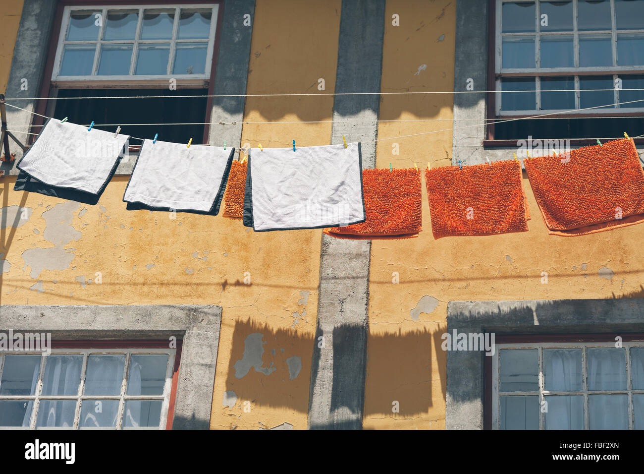 Low Angle View Of Clothesline Against Apartment Building - Stock Image