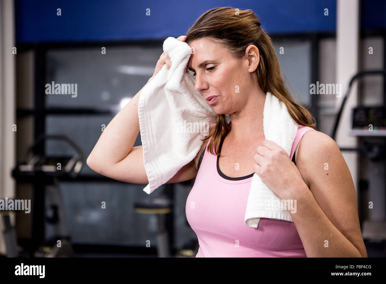 Pregnant woman wiping her sweating - Stock Image
