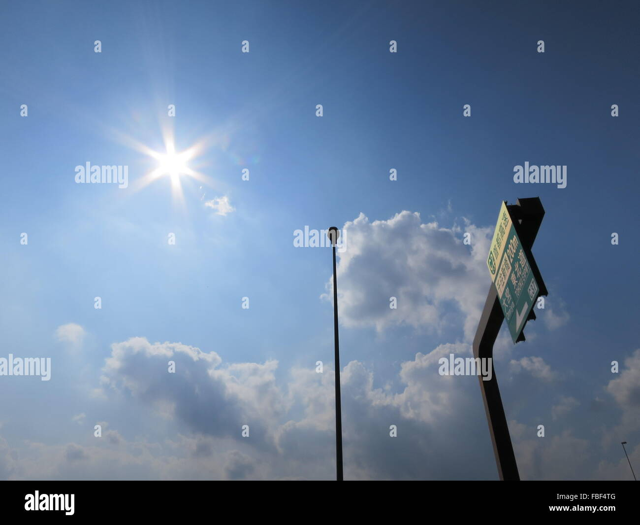 Low Angle View Of Sign Board And Street Light Against Sky Stock Photo
