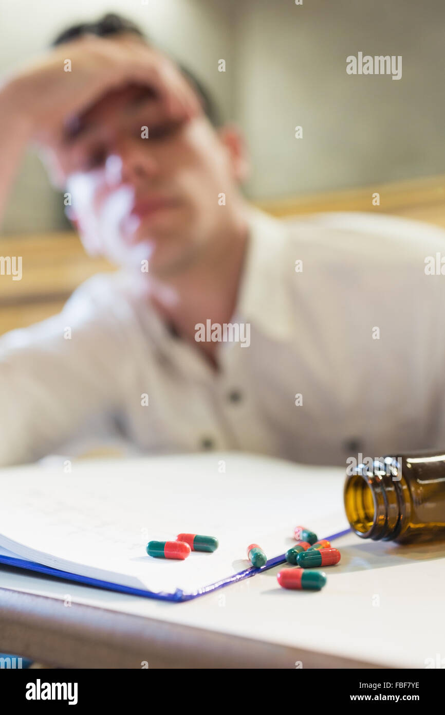 Anxious male student during exam - Stock Image