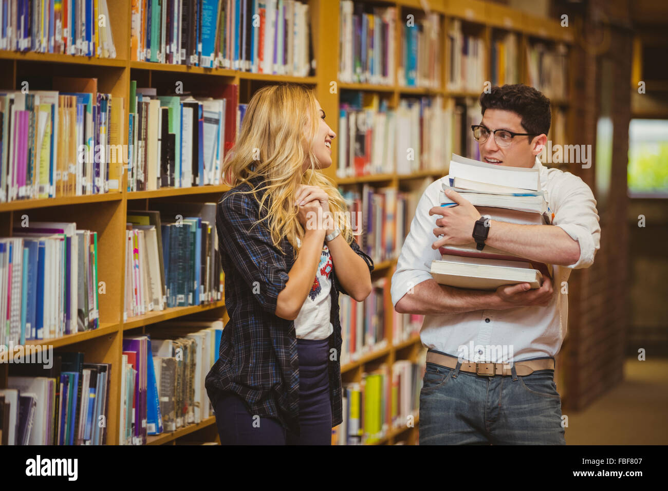 Embarrassed nerd meeting up a girl - Stock Image