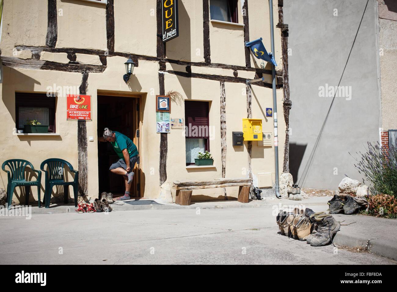 9/9/14 Pilgrim arriving at hostel on Camino de Santiago in Agés, Burgos, Castilla y Leon, Spain - Stock Image