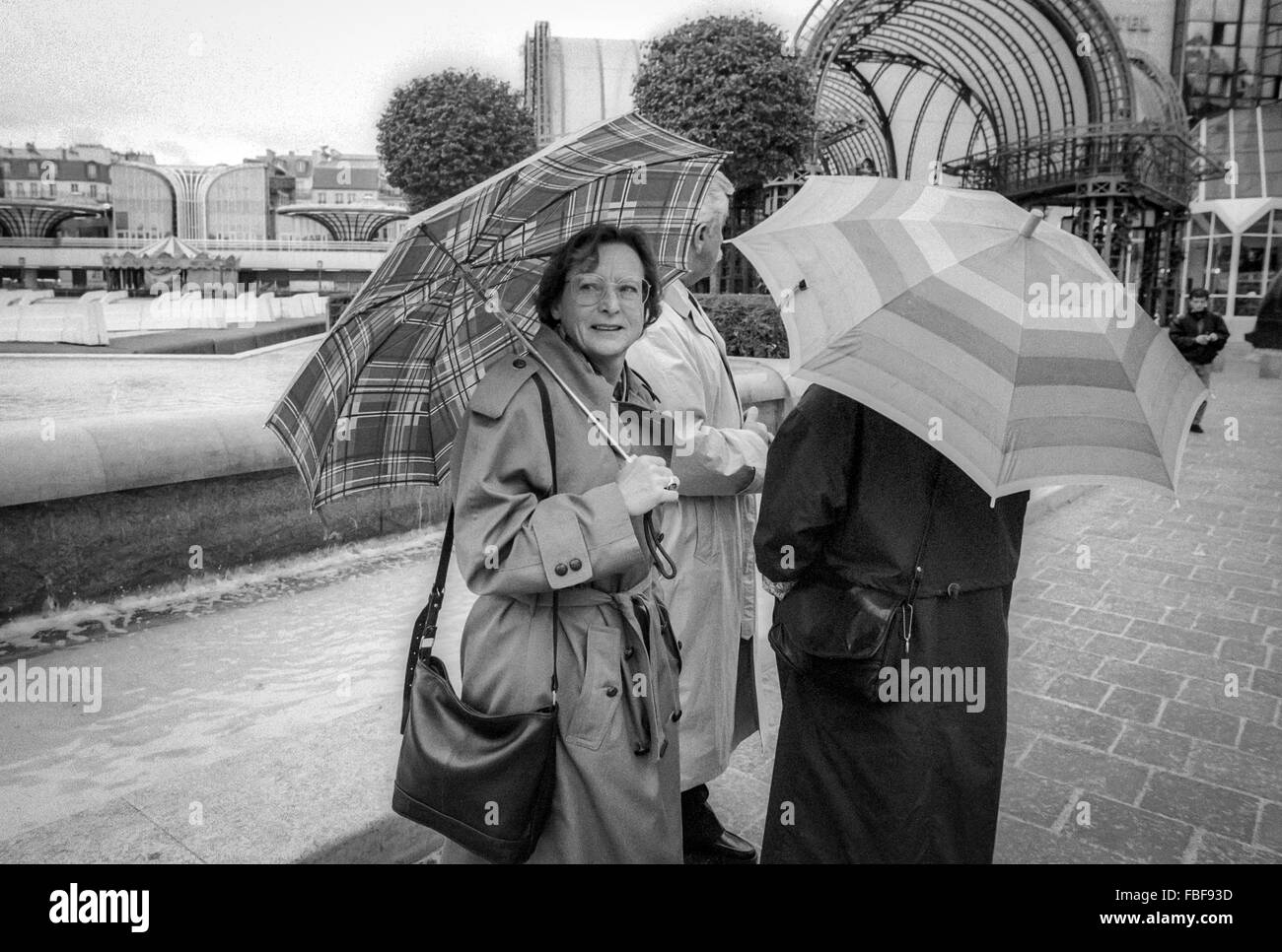 Ladies with umbrellas on the streets of paris in 1990s stock image