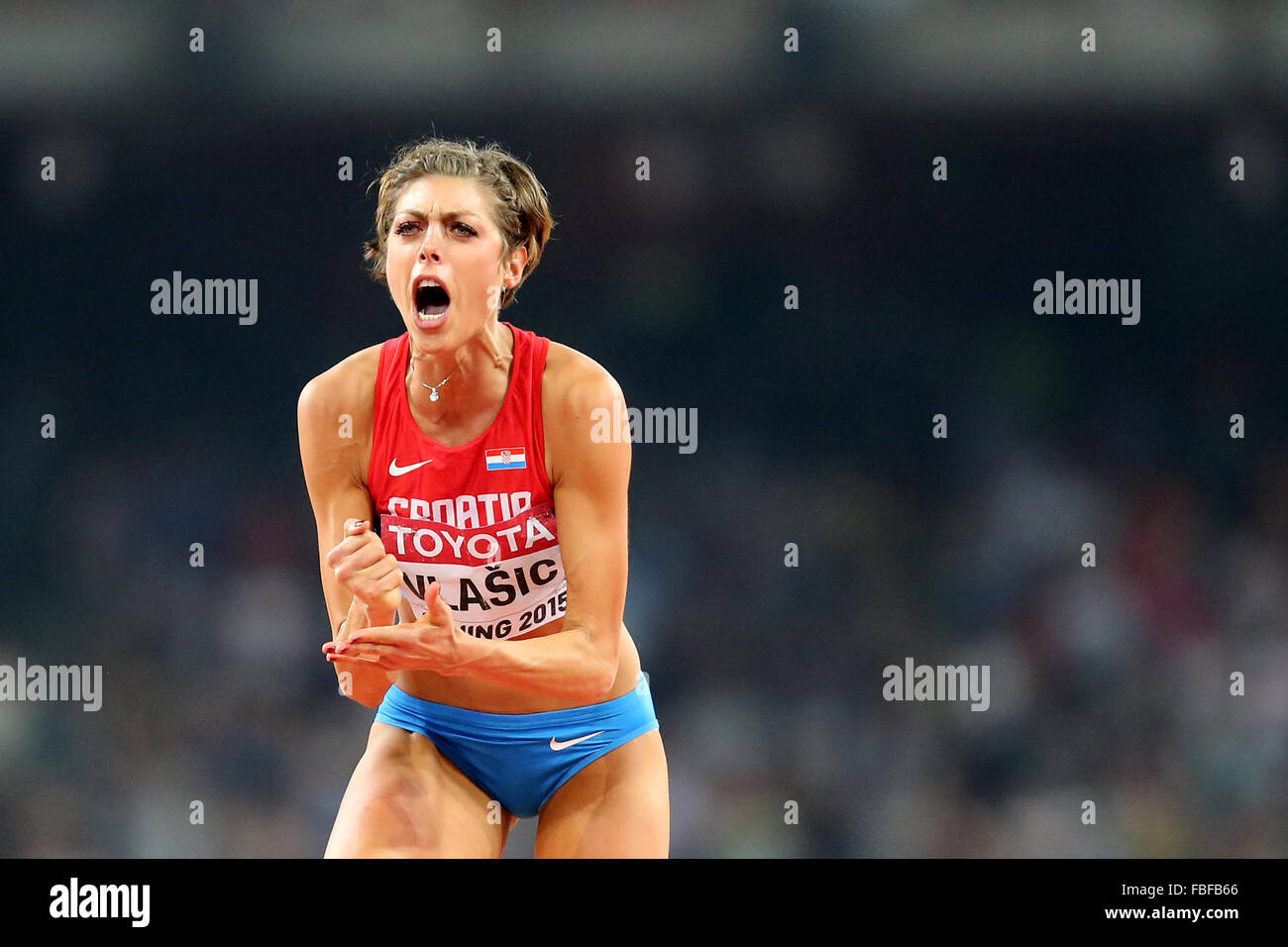 IAAF World Championships, Beijing 2015.Blanka Vlasic of Croatia reacts after winning silver in the Women's High - Stock Image