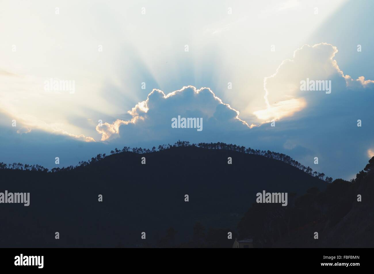 Silhouette Landscape Against Scenic Sky - Stock Image