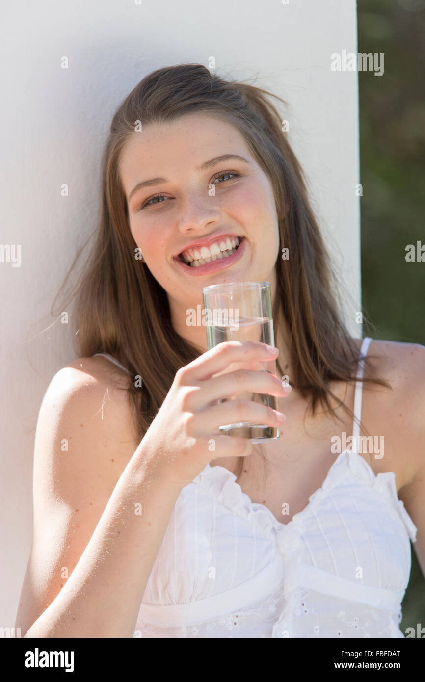Young woman with water glass Stock Photo