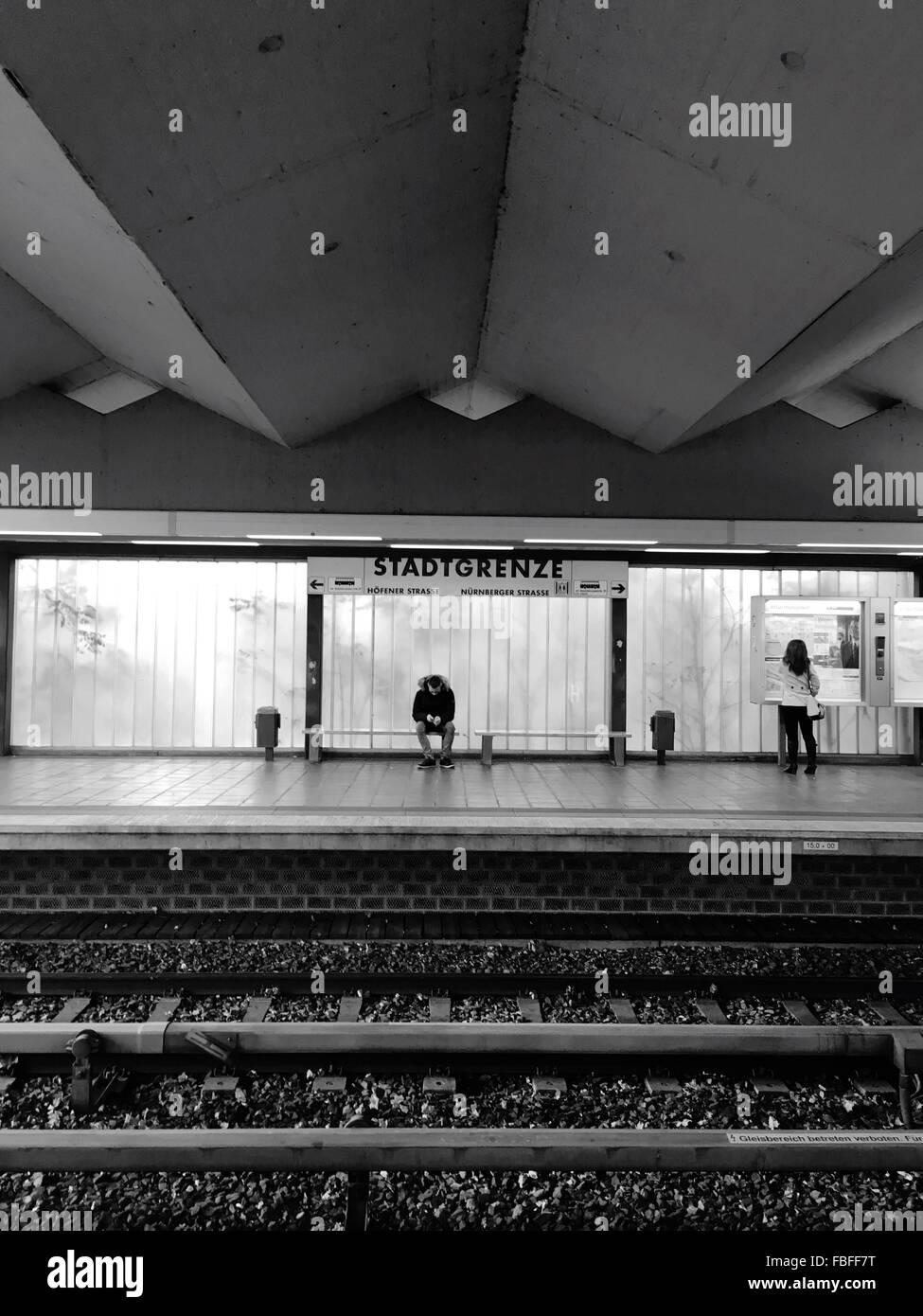 Man And Woman At Railroad Station Platform - Stock Image