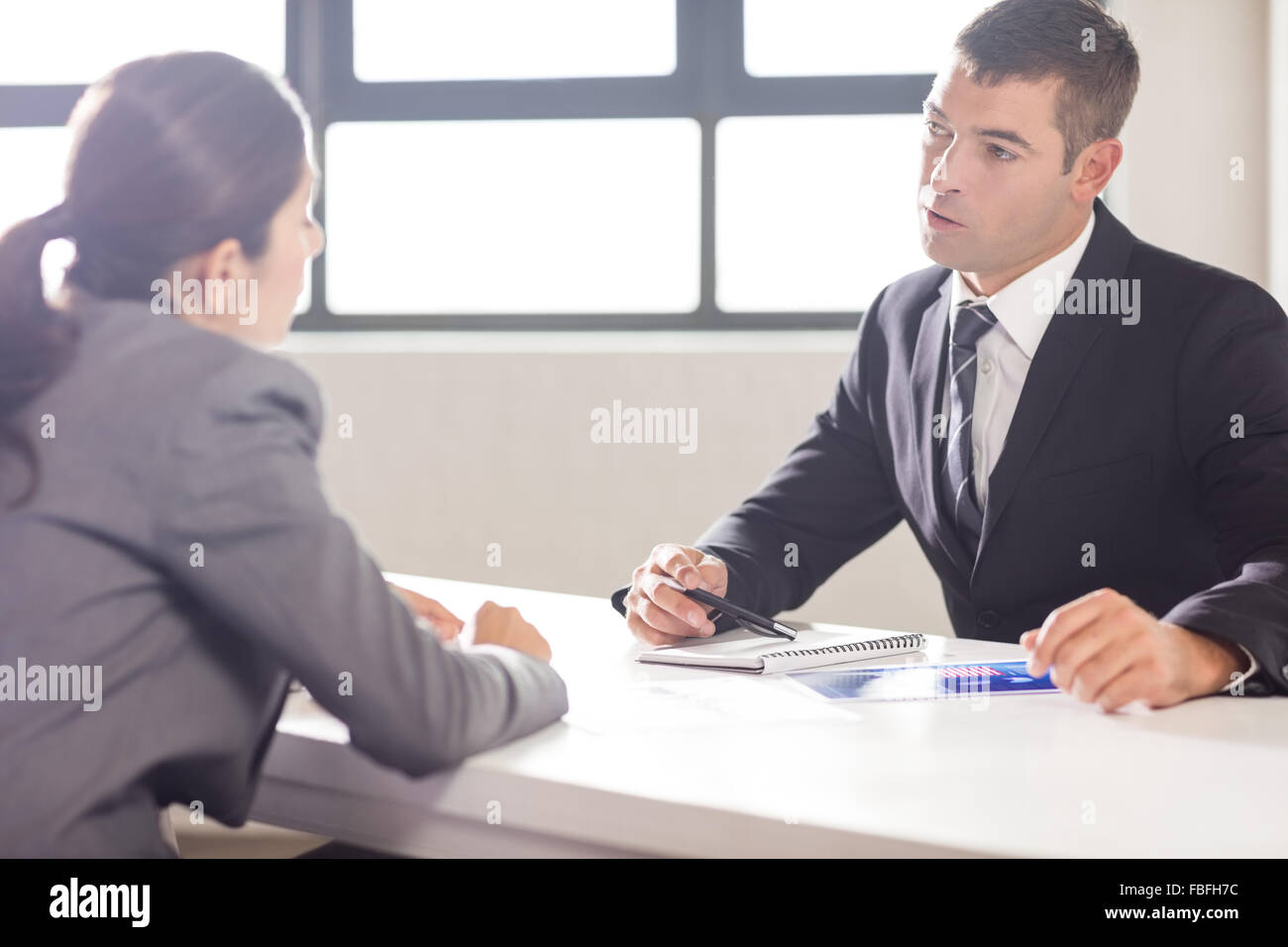 Business people having a conversation - Stock Image