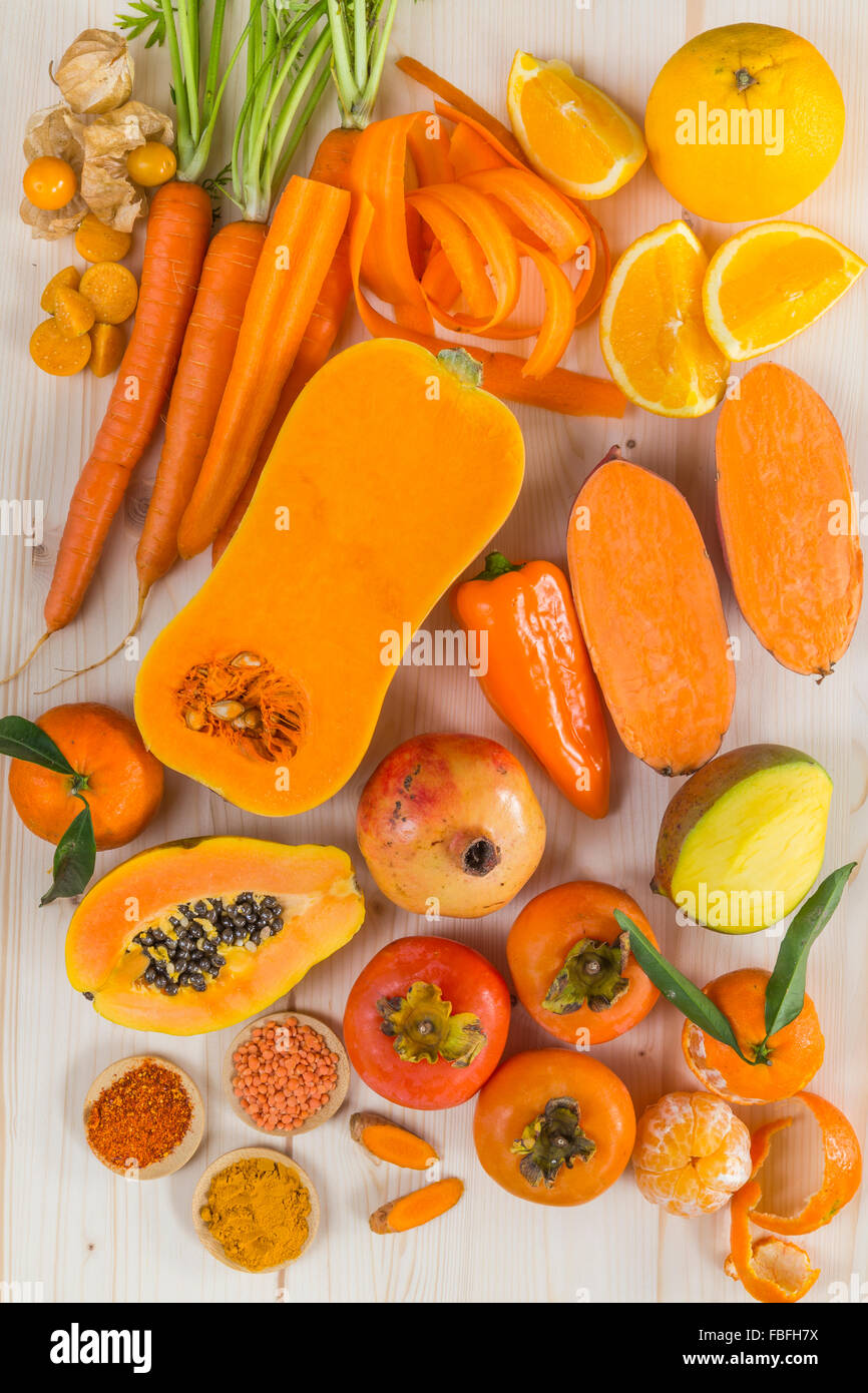 Orange coloured fruit and vegetables - Stock Image