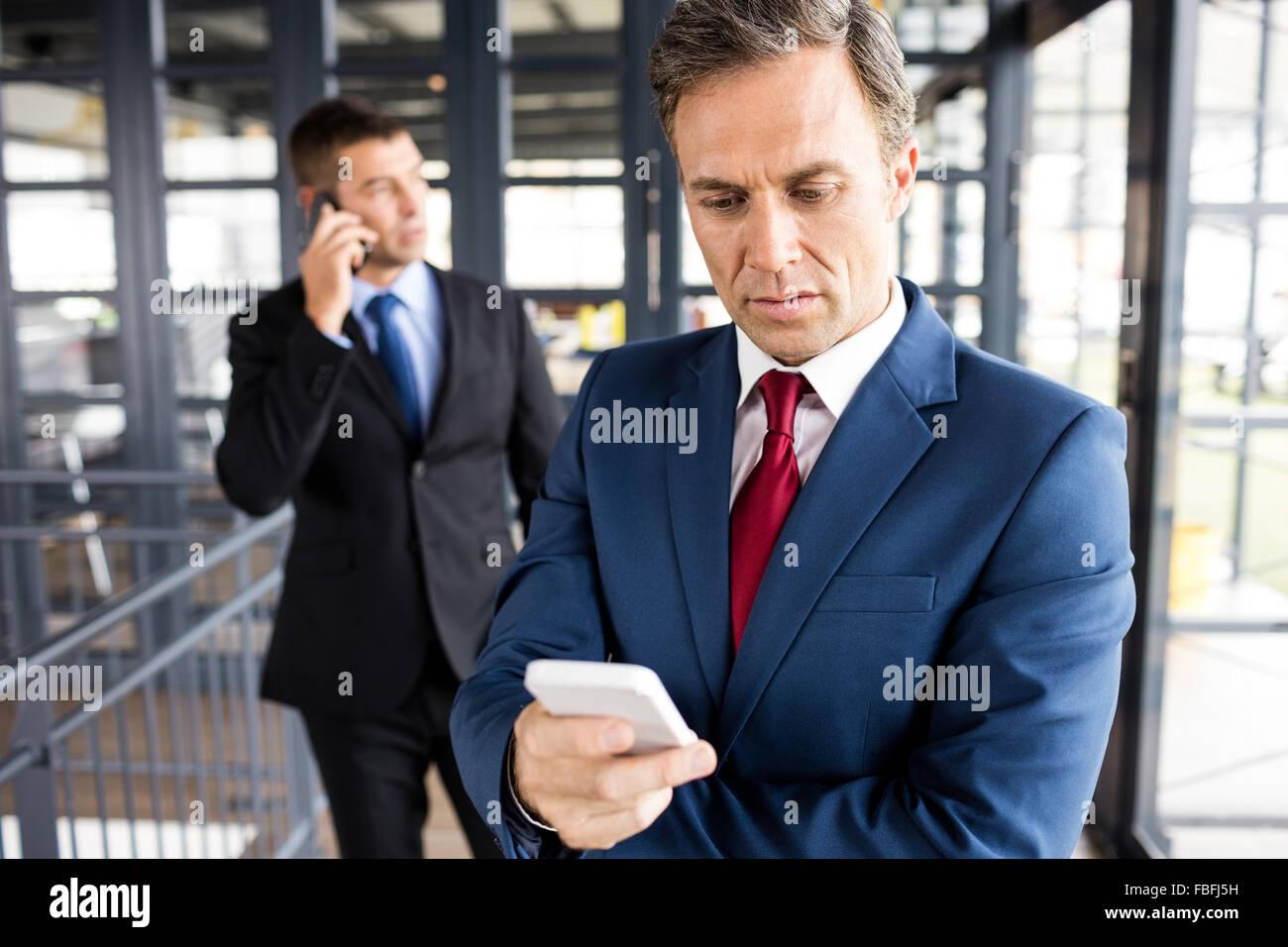 Business people having phone calls - Stock Image