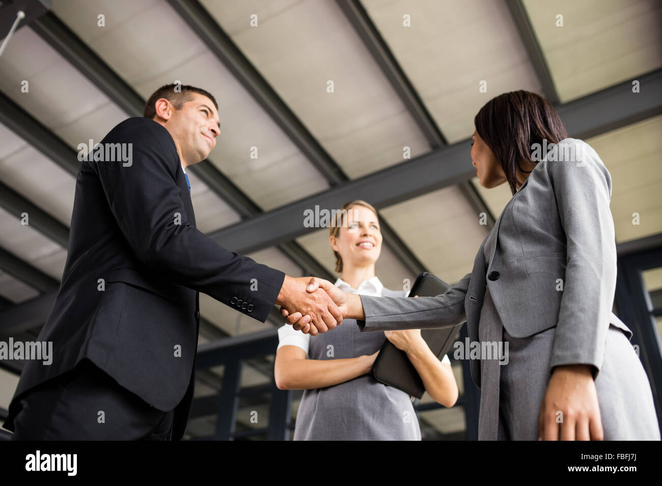 Business people talking together and shaking hands - Stock Image