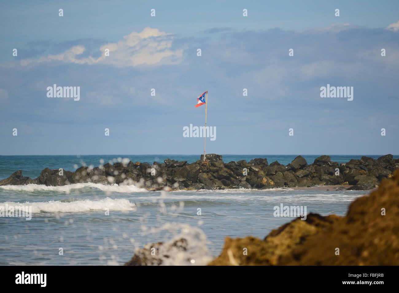 Puertorican Flag Waving At Domes Beach Rincon Puerto Rico USA Territory Caribbean Island