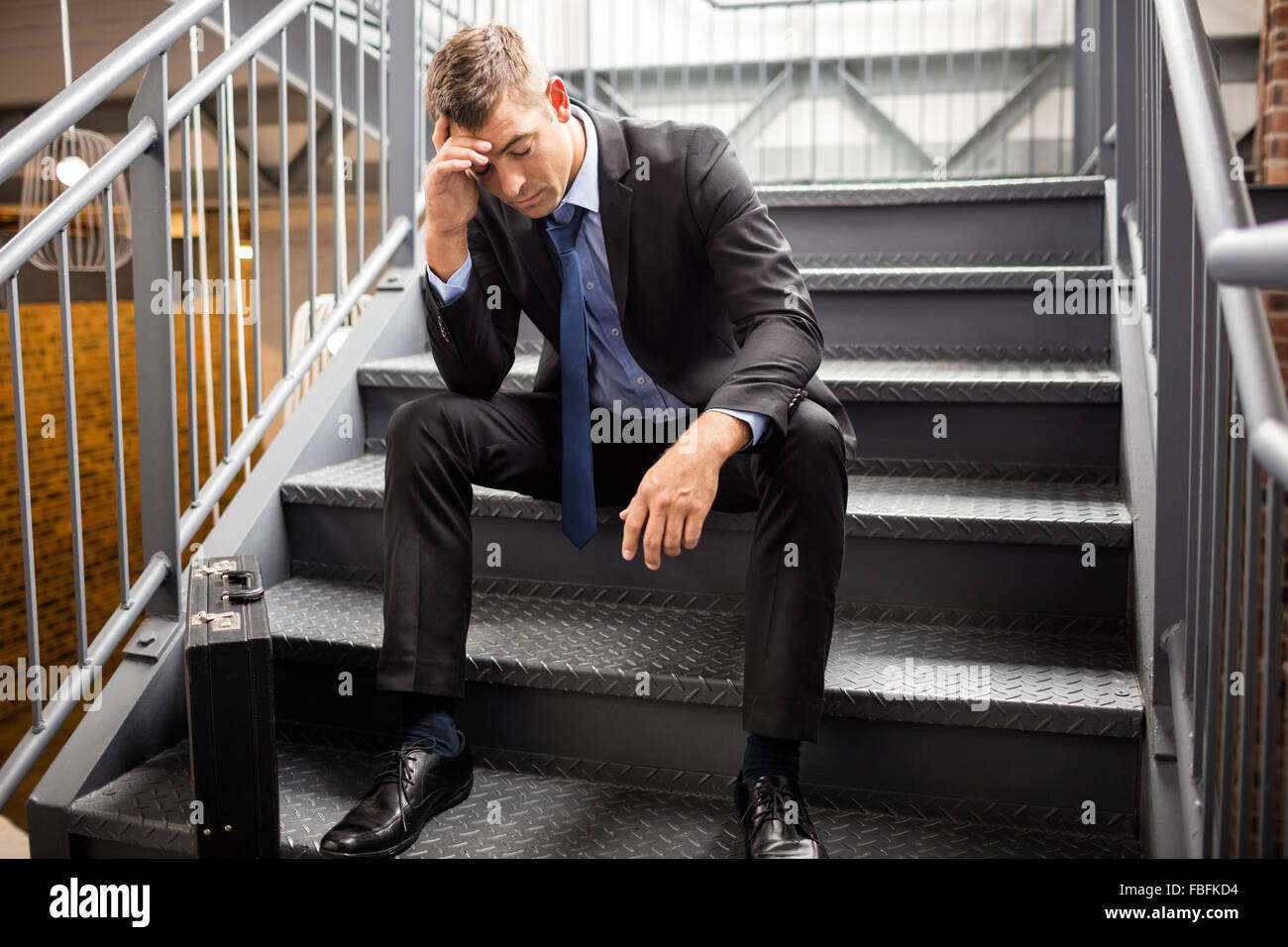 Portrait of a disappointed businessman - Stock Image