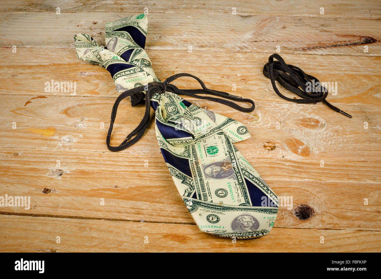 On a shoestring, a tight finances concept - Stock Image