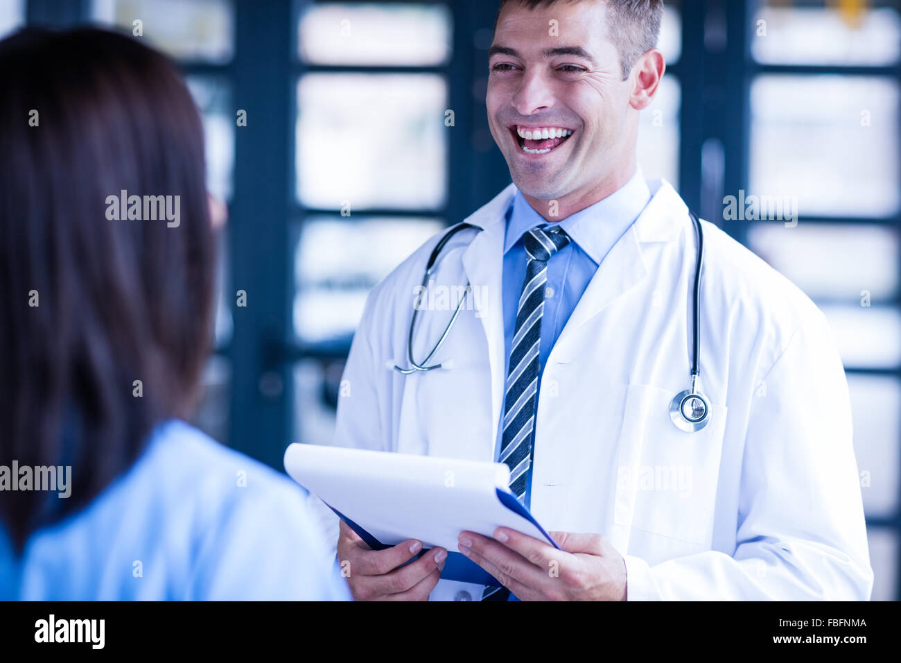 Nurse and doctor smiling - Stock Image