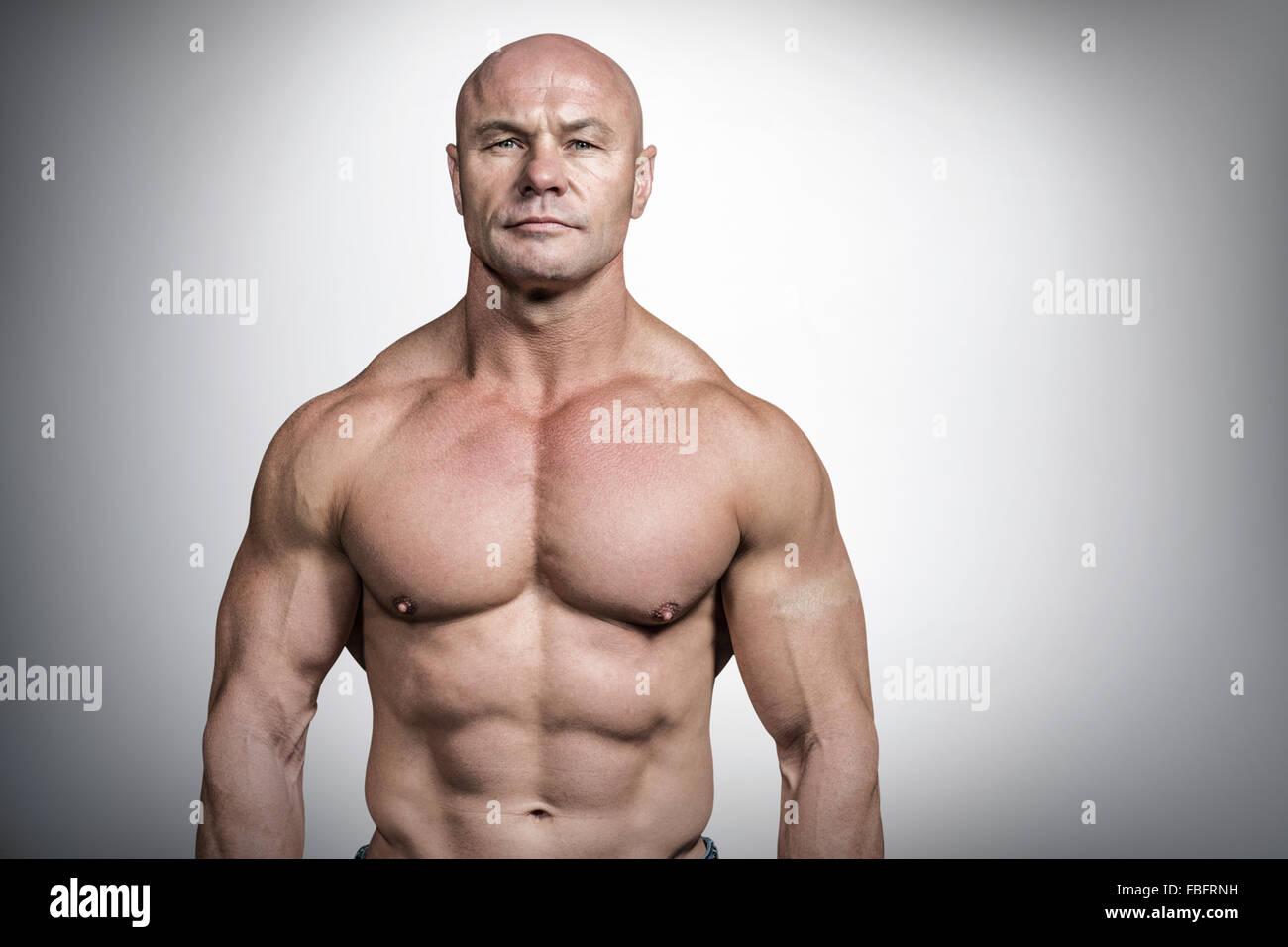 Composite image of portrait of confident bodybuilder man - Stock Image