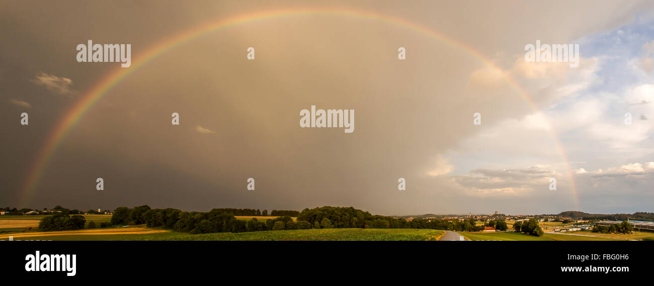 Rainbow in Bavaria after a summer thunderstorm. - Stock Image