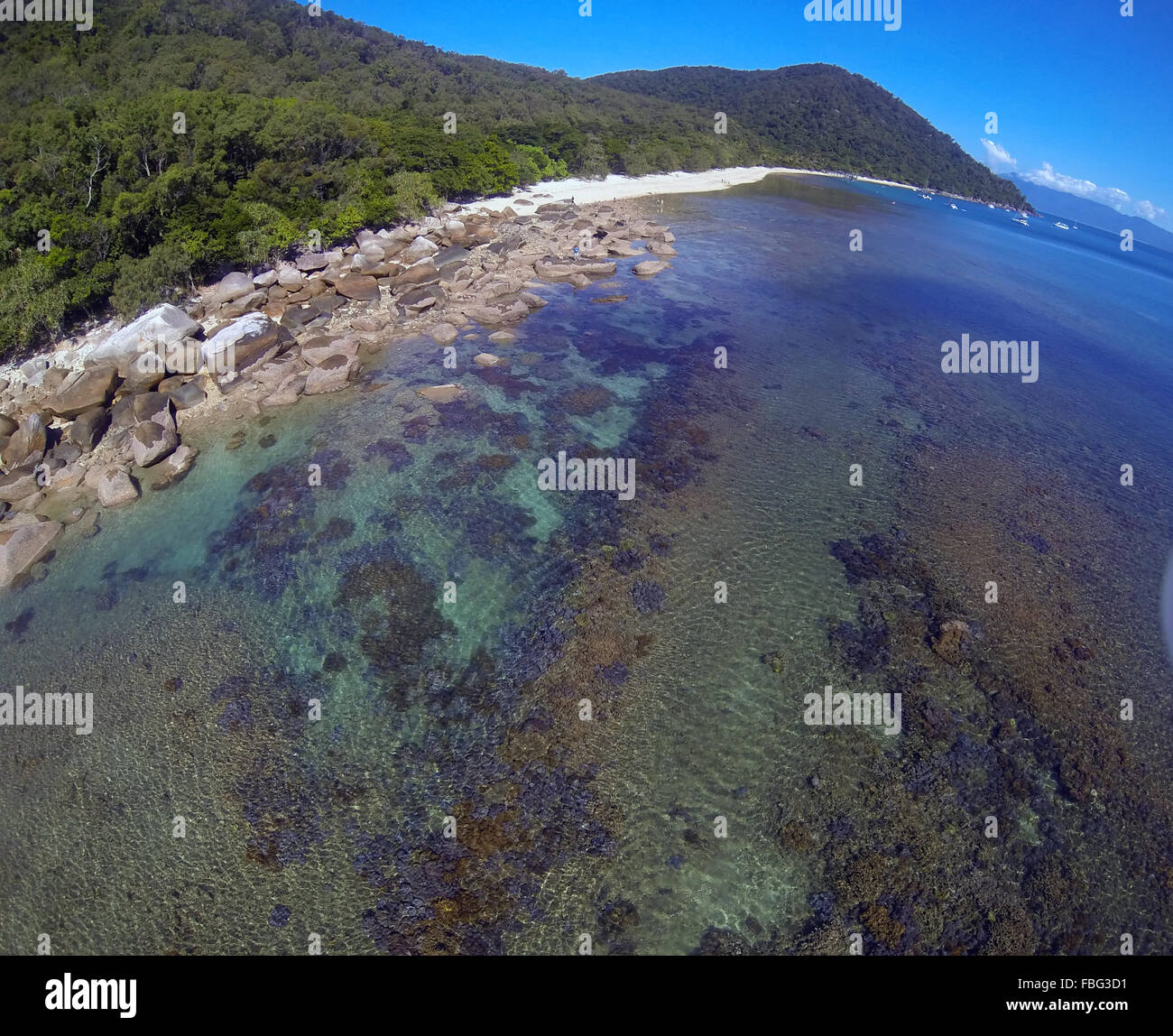 Aerial view of fringing reefs and coastline of Fitzroy Island, Great Barrier Reef Marine Park, Queensland, Australia Stock Photo