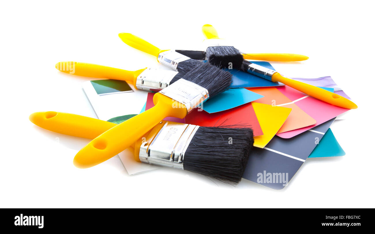 Paint brushes with color cards isolated on a white background - Stock Image