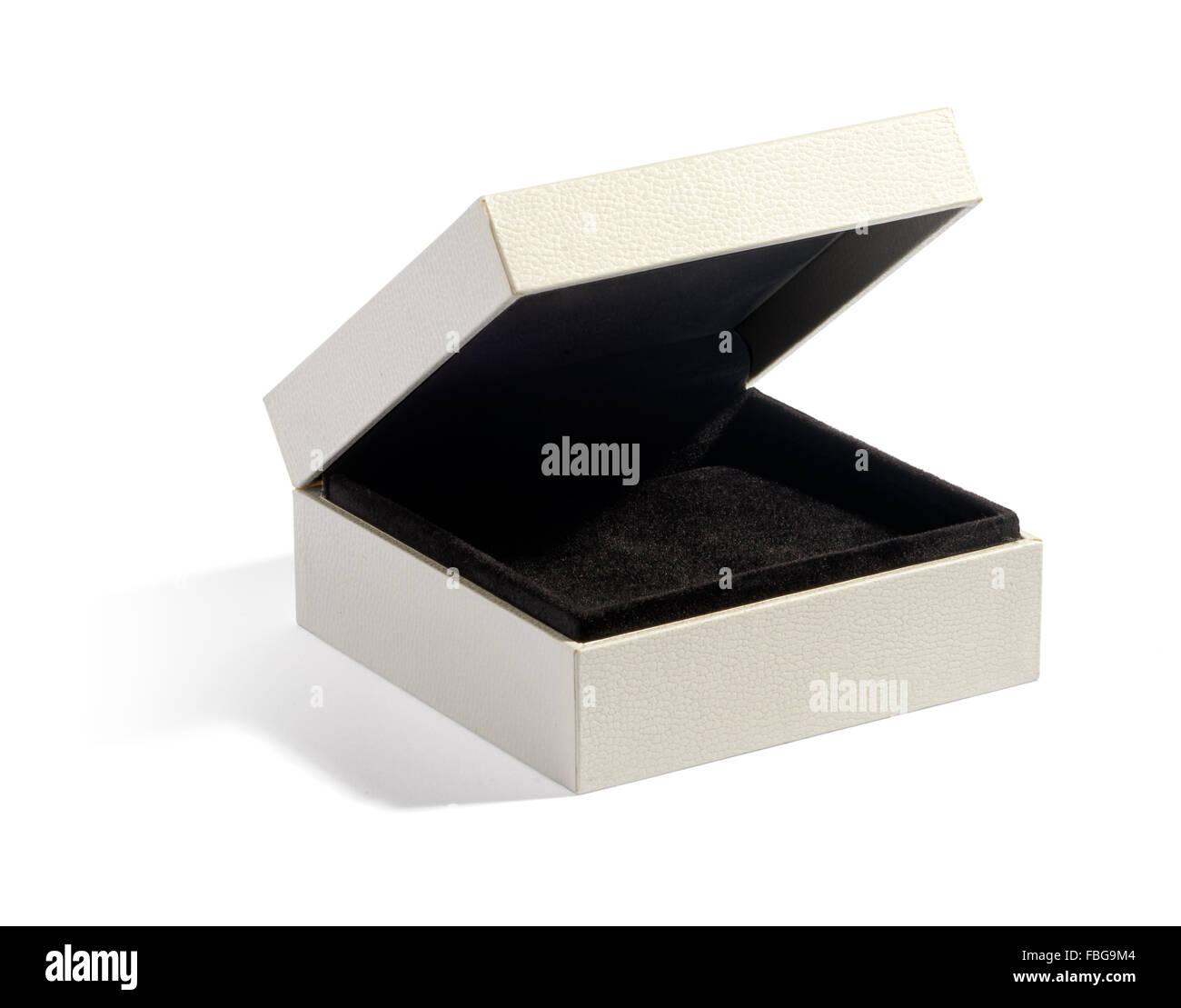 Simple empty half open jewelry box with black felt padding on white background - Stock Image