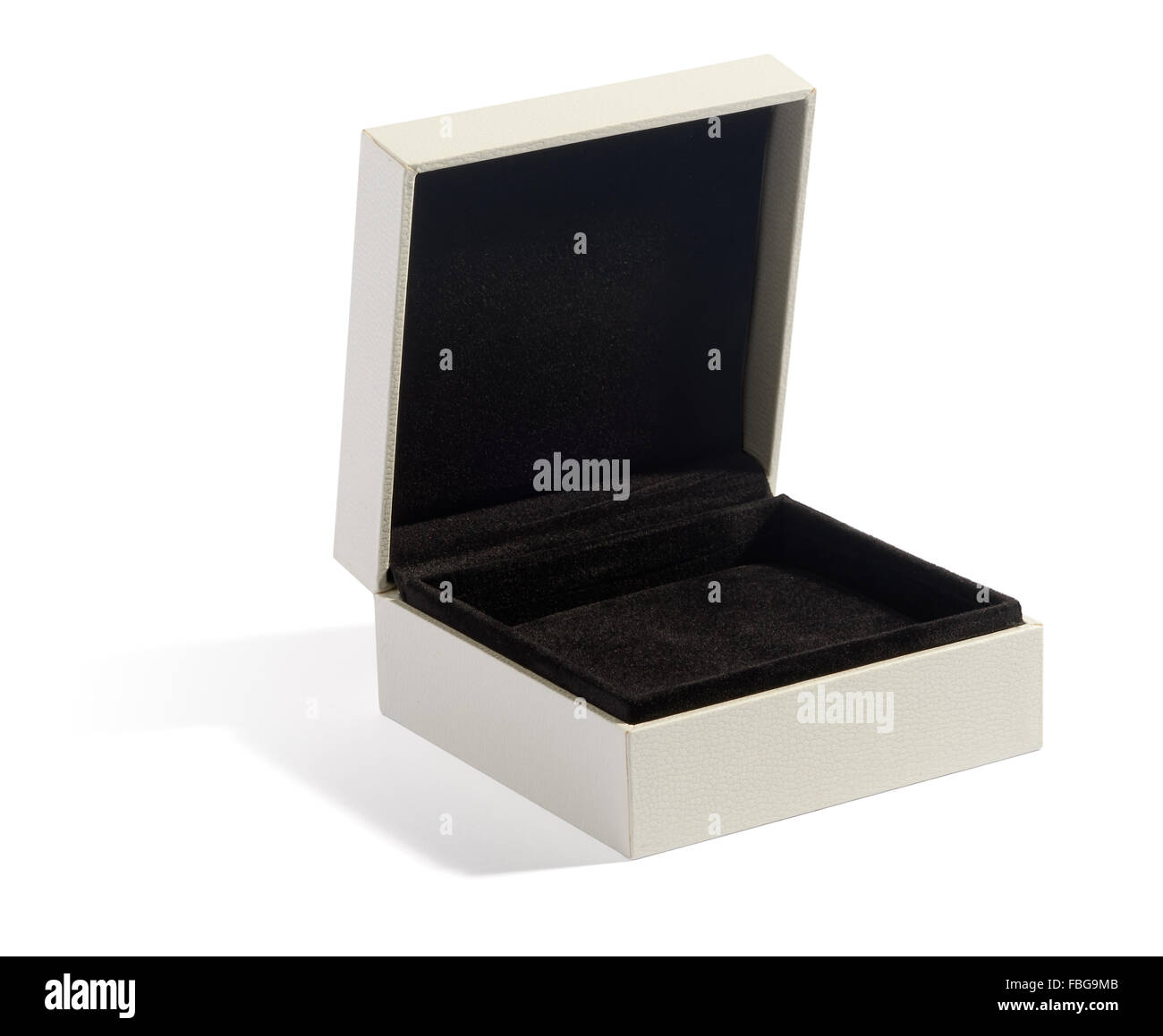 Single wide open jewelry box with black felt padding on white background - Stock Image
