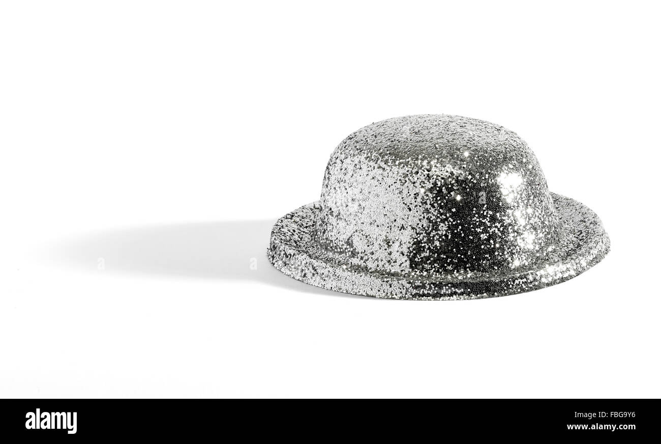 Close up of single glittering silver party or entertainment hat on white background - Stock Image