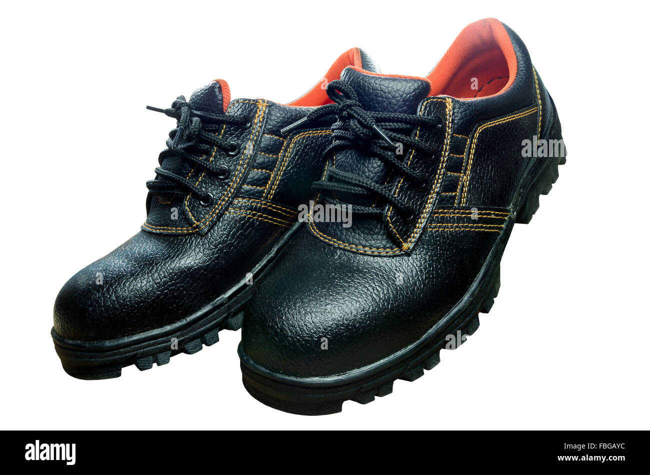 Black steel toe safety of steel cap work boots on white blackground. - Stock Image