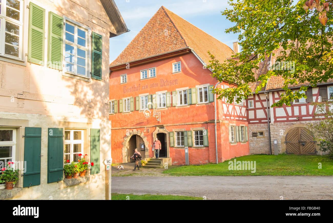 visitors in front of the red ox inn serving the open air museum, wackershofen, schwäbisch hall, baden-wuerttemberg, - Stock Image