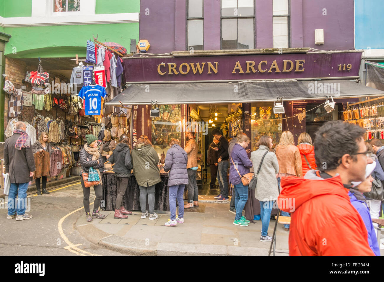 visitors of portobello road market in front of crown arcade store, notting hill, london, england - Stock Image