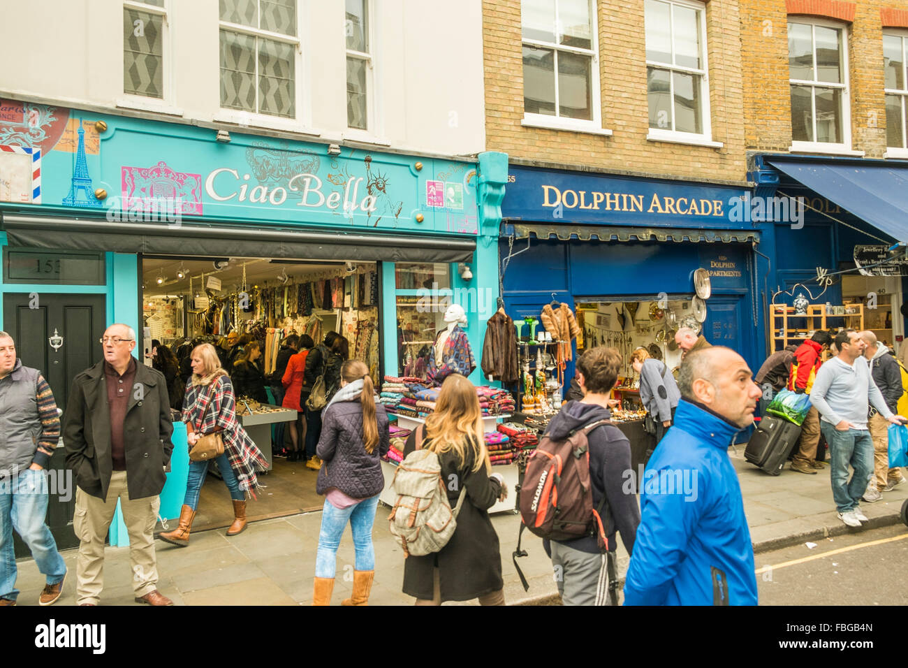 visitors of portobello road market in front of ciao bella and dolpin arcade stores, notting hill, london, england - Stock Image