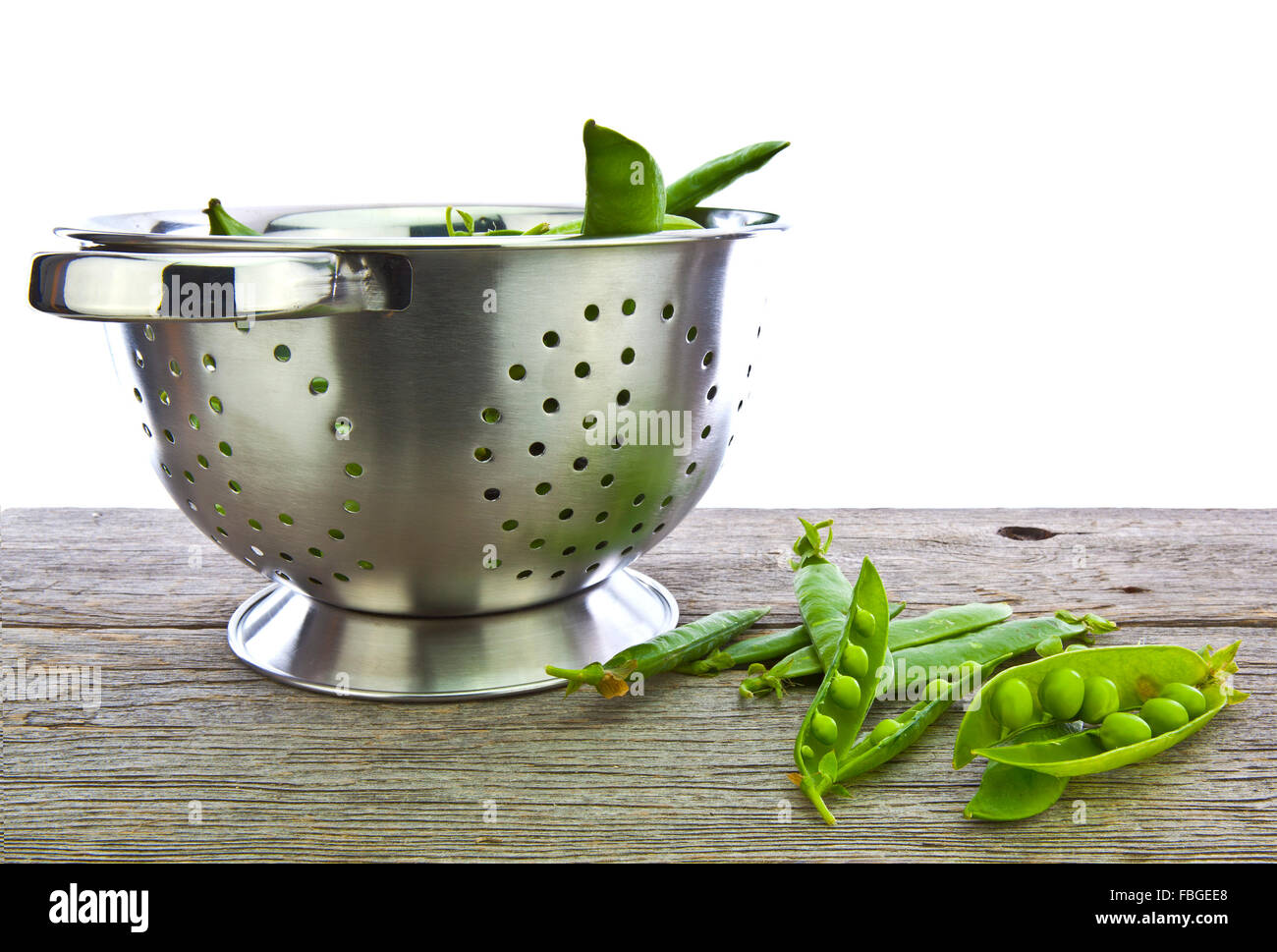 Freshly picked home grown organic peas in a colander - Stock Image