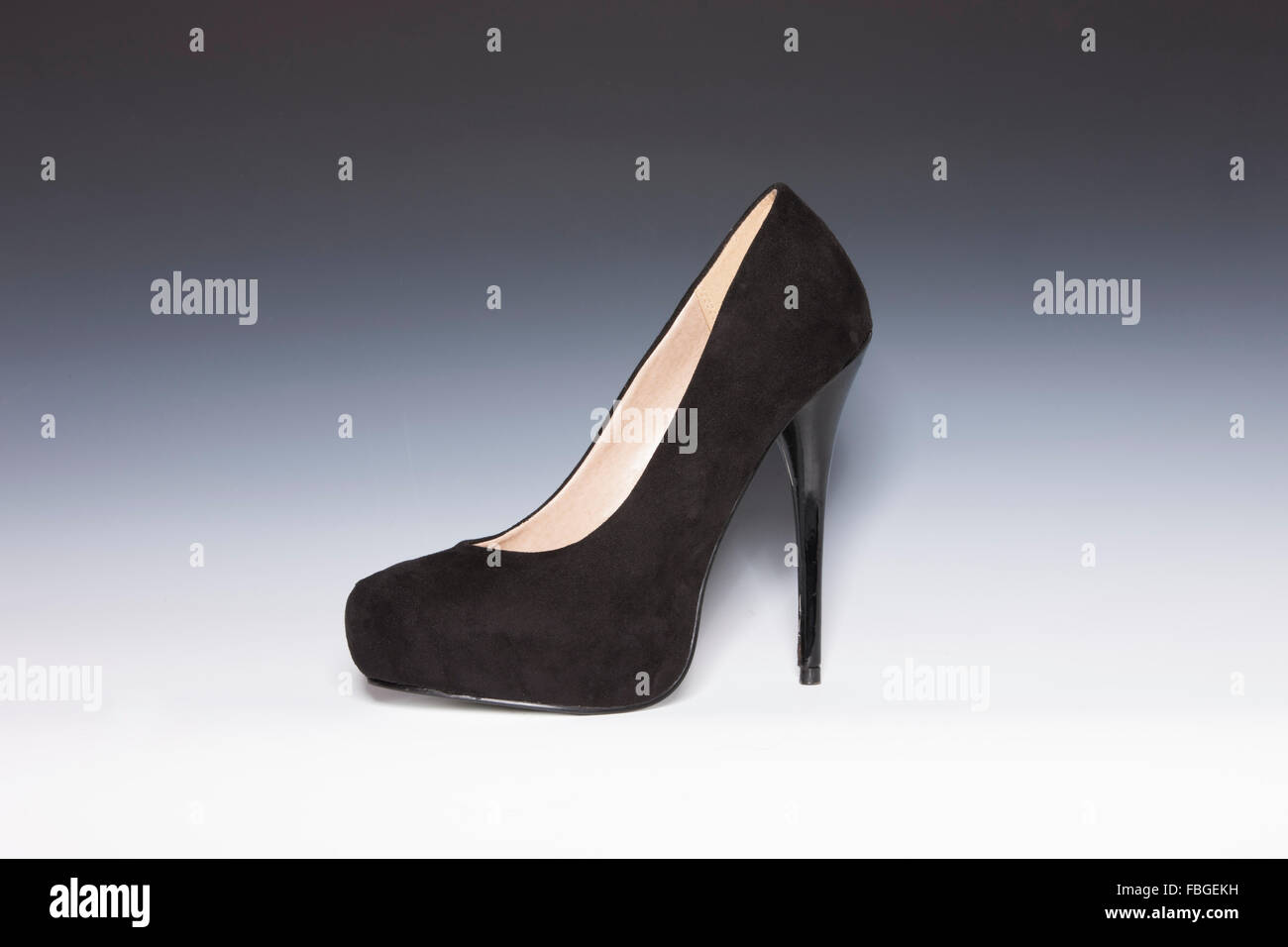 Suede and leather black womems stilettos. Stock Photo