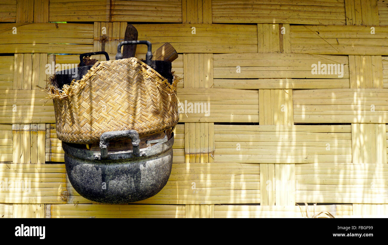 Local stove kitchen outdoor on woven bamboo strips wall venecular in Loas Stock Photo