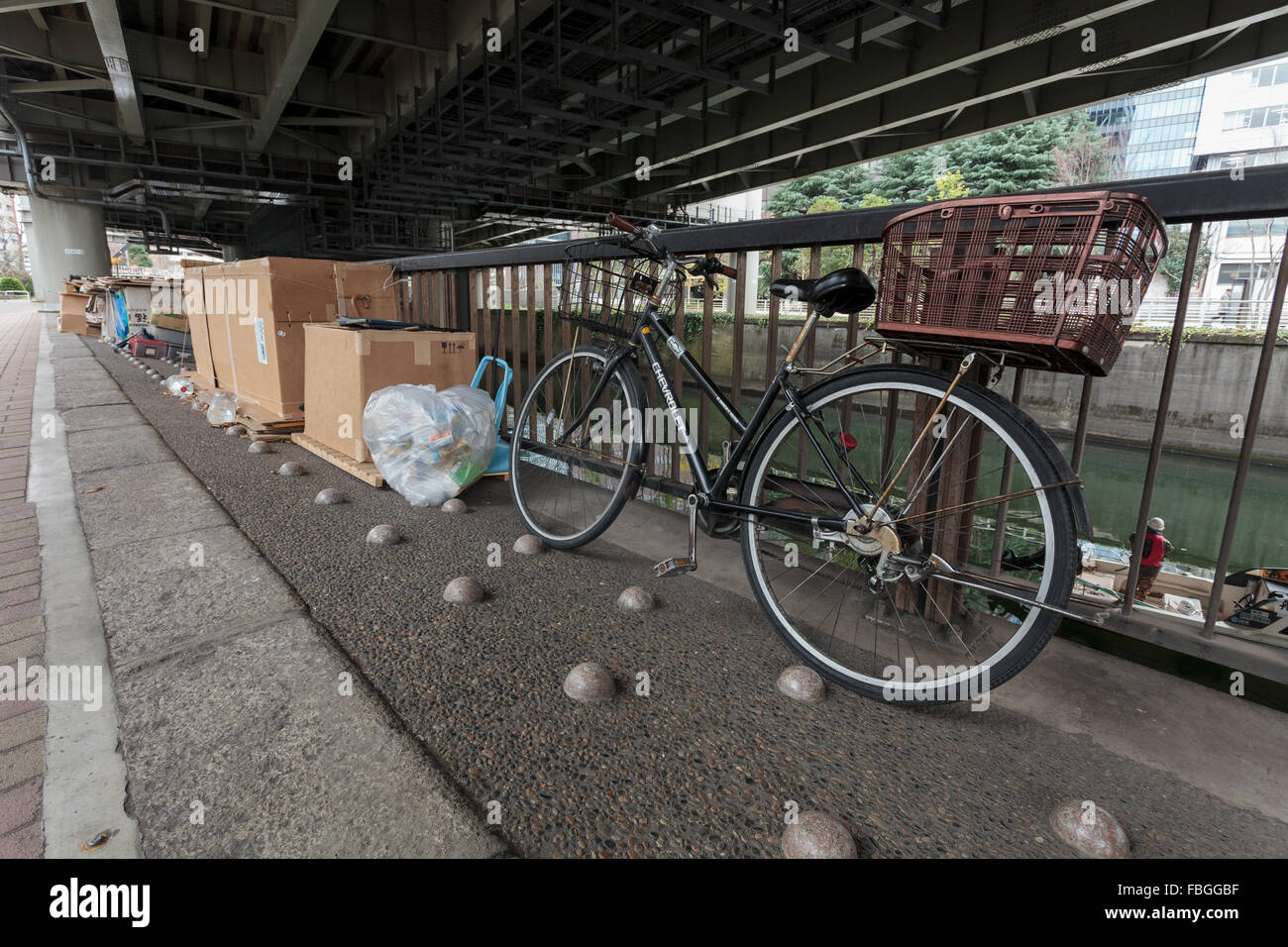 Bumps put in the ground to stop homeless people sleeping there by a riverside in Jinbocho, Tokyo, Japan. January - Stock Image