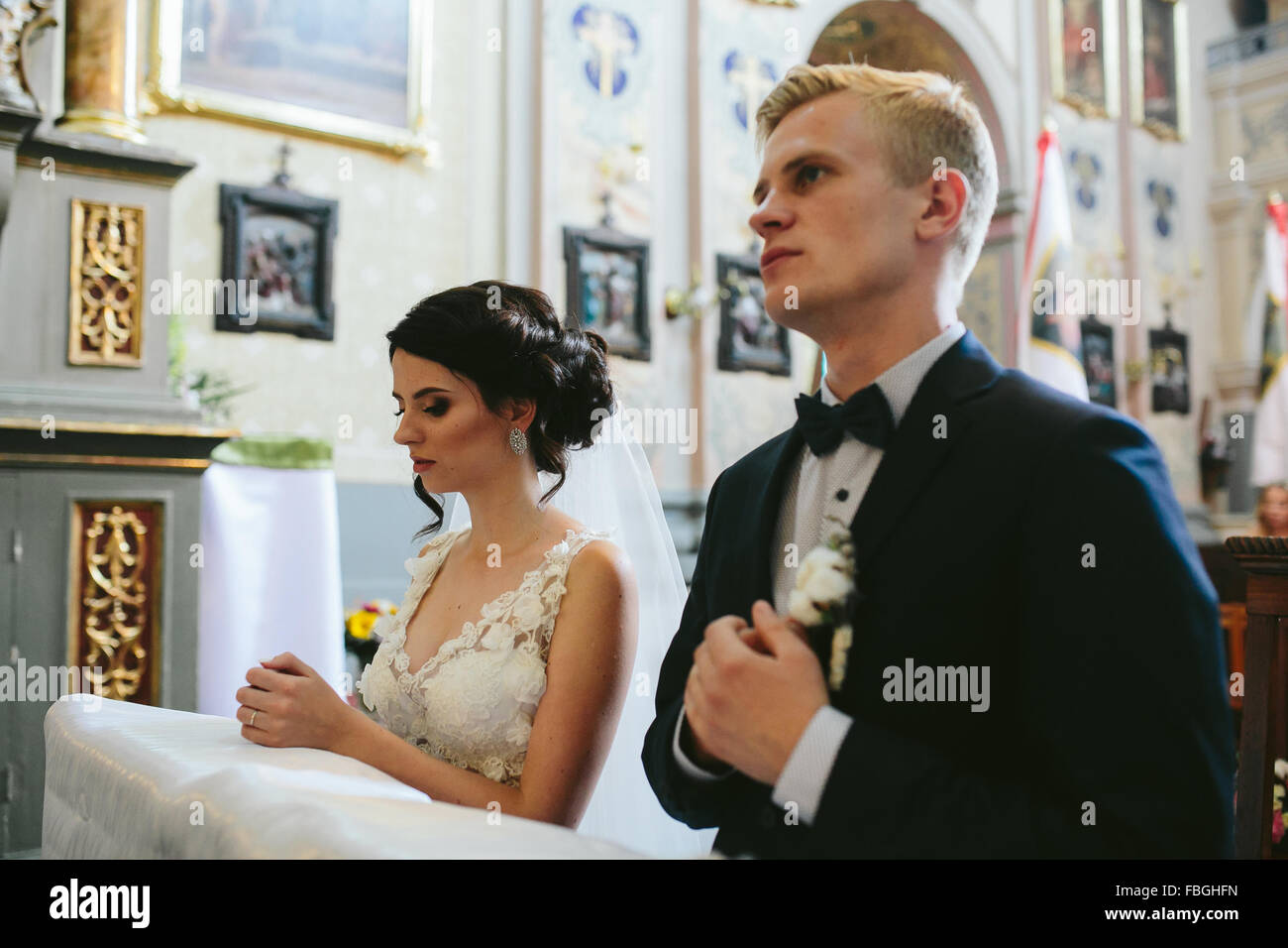Bride and groom in the church - Stock Image