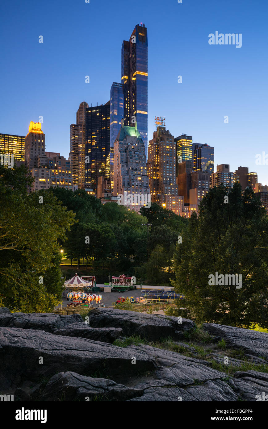 Twilight view of Central Park South skyscrapers including One57, Essex House and the Hampshire House. Manhattan, - Stock Image