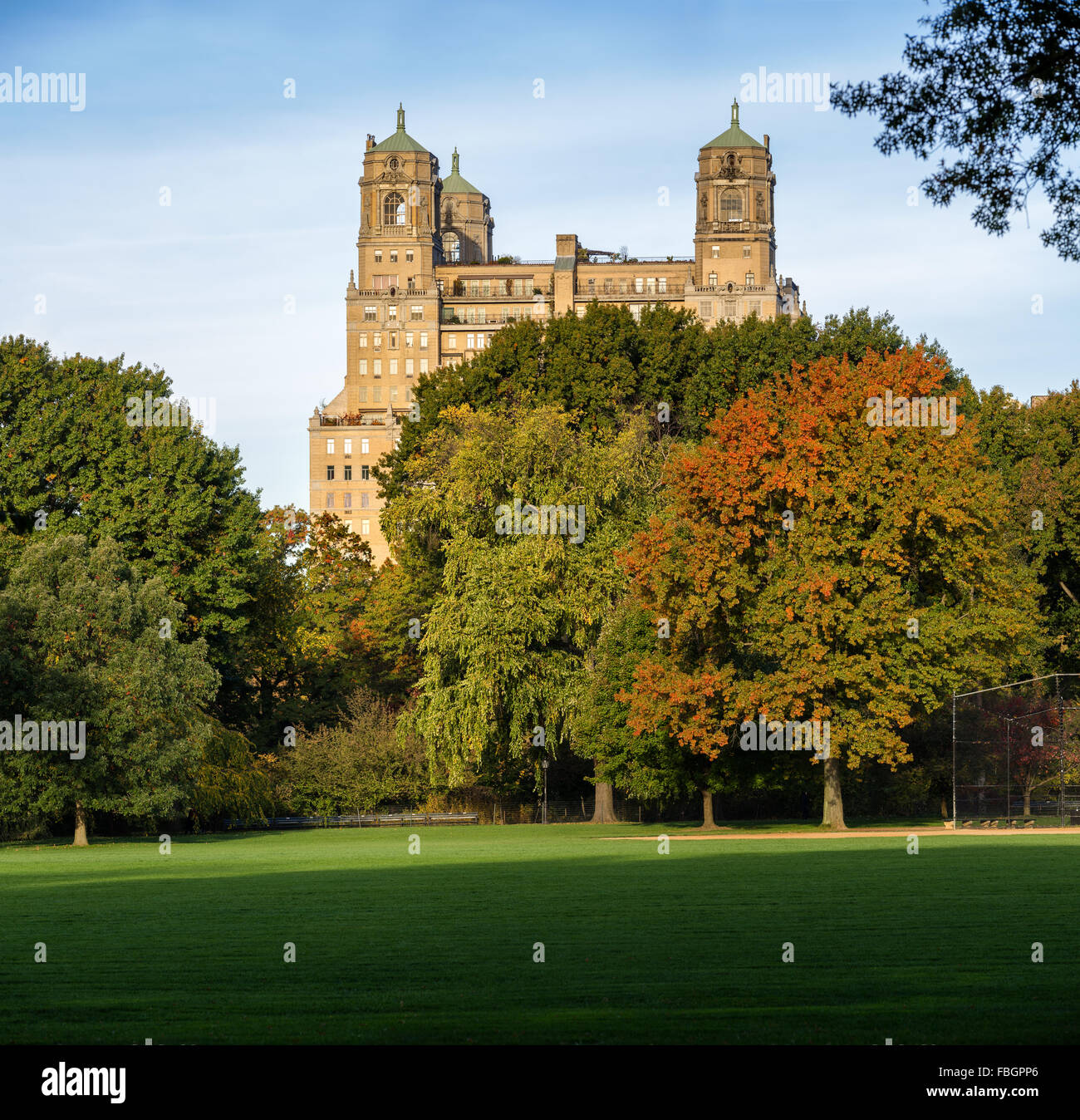 Quiet autumn view of the Beresford Building across Central Park Great Lawn in Upper West Side, Manhattan, New York - Stock Image