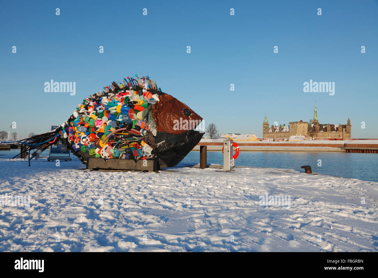 The giant fish, a work of street art made of garbage and old plastic items in snow-covered Elsinore Harbour, the - Stock Image