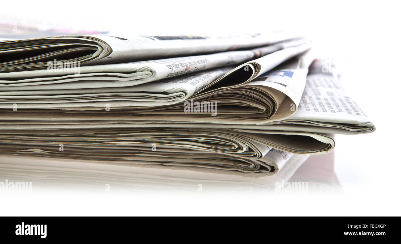 Various newspapers over white background - Stock Image