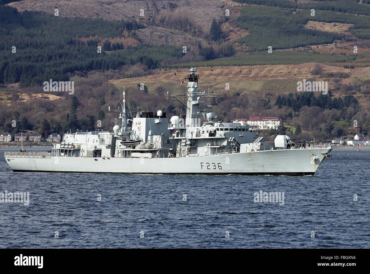 HMS Montrose, a Type 23 or Duke-class frigate of the Royal Navy, approaches Cloch Point after taking part in Joint Warrior 13-1. Stock Photo