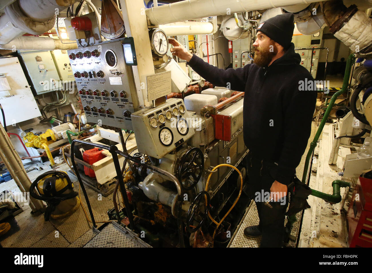 Hamburg, Germany. 8th Jan, 2016. Mashinist Peer Maak stands in the engine room of the former research vessel 'Clupea' - Stock Image